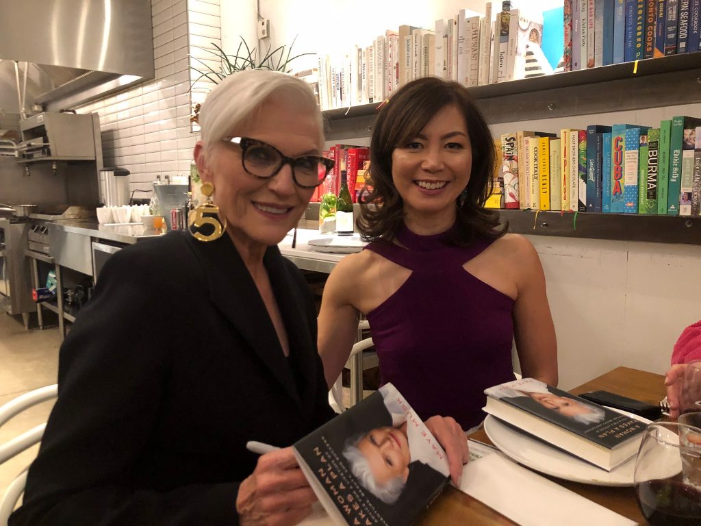 Maye Musk signing her book for Sue Mah