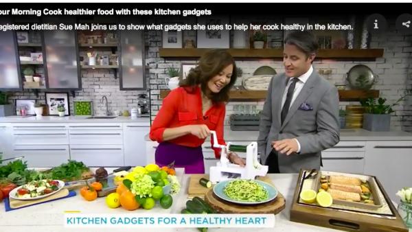 Registered Dietitian shows TV host Ben Mulroney how to work a spiralizer kitchen gadget.
