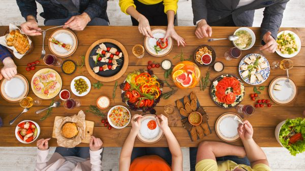 people eating together at a wood table